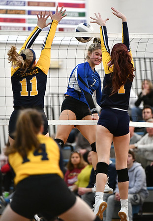 11/16/2019 Mike Orazzi | StaffrBristol Easterns Zoe Lowe (7) and Woodstock Academy's Katherine Papp (11) and Sierra Bedard (1) during the 2019 State Girls Volleyball Tournament Class L Quarterfinals at BEHS in Bristol Saturday.