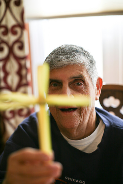 Papa Charlie folds a palm into a cross during early Easter celebration with the family in Oak Forest, Illinois on April 17, 2011.  (Jay Grabiec)