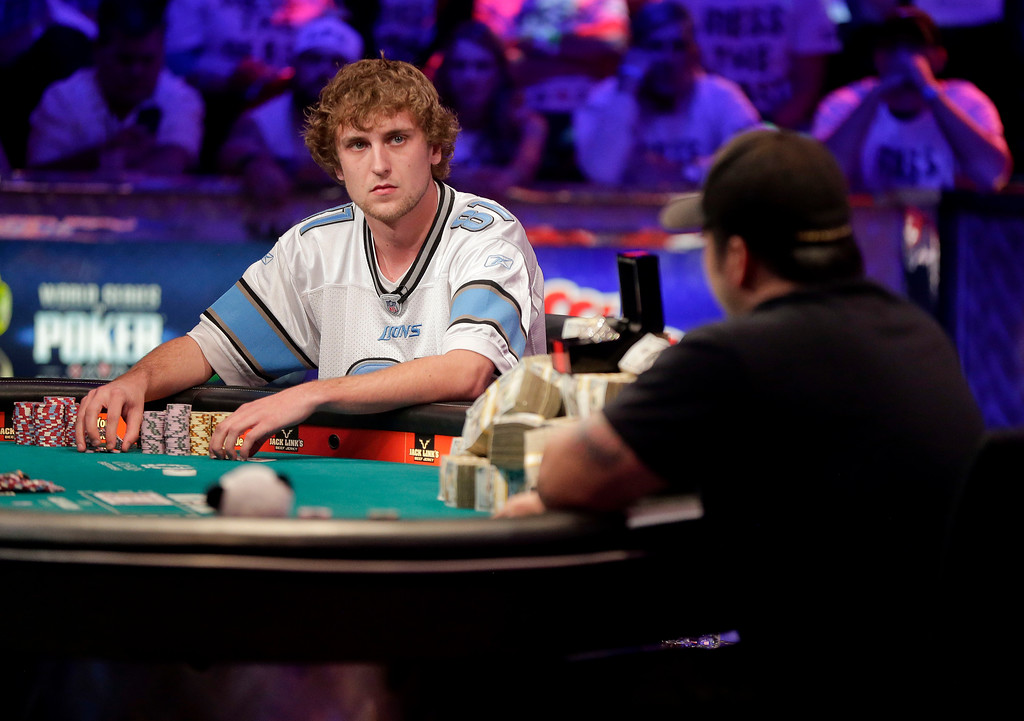 . Ryan Riess, left, waits for a play from Jay Farber during the World Series of Poker final table, Tuesday, Nov. 5, 2013, in Las Vegas. (AP Photo/Julie Jacobson)