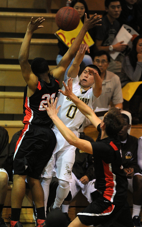 . TORRANCE - 02/15/2013 - (Staff Photo: Scott Varley/LANG) In a CIF Southern Section Division III-AAA second-round boys basketball matchup, West beat Hart 64-55. Under pressure, West\'s Ethan Kishimoto passes the ball off.