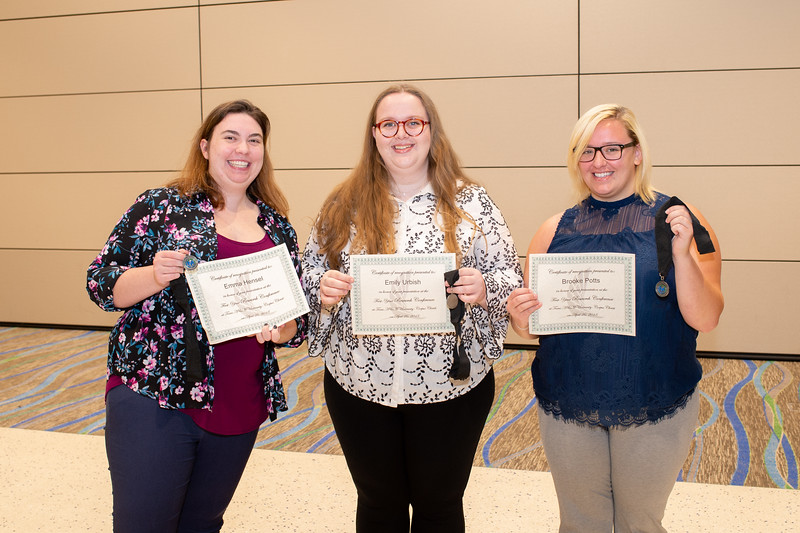 Following their FYI presentations, Emma Hansel (left), Emily Urbish, and Brooke Potts gather for a photo in the Anchor Ballroom.