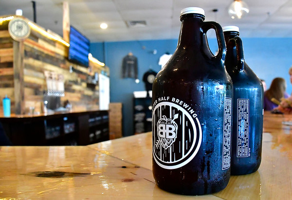 7/27/2019 Mike Orazzi | Staff Growlers at Better Half Brewing in downtown Bristol on Saturday.