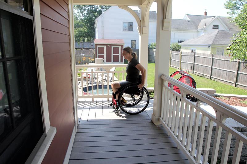 AMY SWEENEY/Staff photo.   Chris Slavin moved to Danvers three years ago because of the handicap access apartment she was able to get. It is on Cherry Street in town. She loves that it is so easy to get around town. July 3, 2018