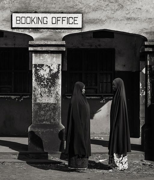 Two Muslim women talking outside the train station.  Moshi, Tanzania, 2019
