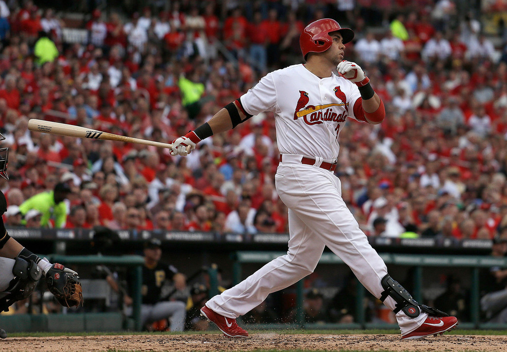 . St. Louis Cardinals\' Carlos Beltran follows through on a three-run home run against the Pittsburgh Pirates in the third inning of Game 1 of baseball\'s National League division series, Thursday, Oct. 3, 2013, in St. Louis. (AP Photo/Jeff Roberson)