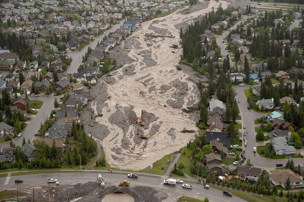 . This aerial photo shows Cougar Creek running through Canmore, Alberta, Canada, on Friday June 21, 2013.  Flooding forced the western Canadian city of Calgary to order the evacuation of the entire downtown area on Friday, as the waters reached the 10th row of the city\'s hockey arena. (AP Photo/The Canadian Press, Jonathan Hayward)