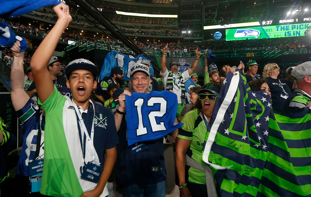 . Seattle Seahawks fans cheer during the first round of the NFL football draft, Thursday, April 26, 2018, in Arlington, Texas. (AP Photo/Michael Ainsworth)