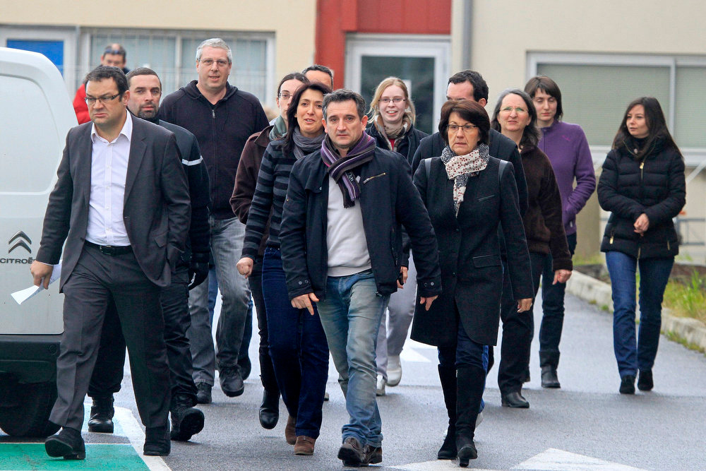 . Christophe Giry (L), Spanghero\'s sales director, surrounded by employees, leaves a works council at the French meat processor Spanghero\'s factory in Castelnaudary, France on February 15, 2013. A French inquiry into how horsemeat got into ready-made-meals sold across Europe found that the Spanghero firm labelled meat as beef when it knew what it was processing may have been horse. The president of French meat processor Spanghero promised on Friday to disprove allegations that his firm knowingly sold horse meat labelled as beef, and accused the government of being too quick to point the finger.    REUTERS/Jean-Philippe Arles