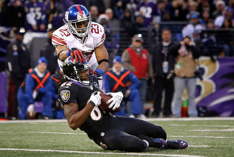 . Baltimore Ravens receiver Torrey Smith (82) hauls in a catch for a touchdown ahead of New York Giants cornerback Corey Webster (23) during the first half of their NFL football game in Baltimore, Maryland, December 23, 2012. REUTERS/Jonathan Ernst