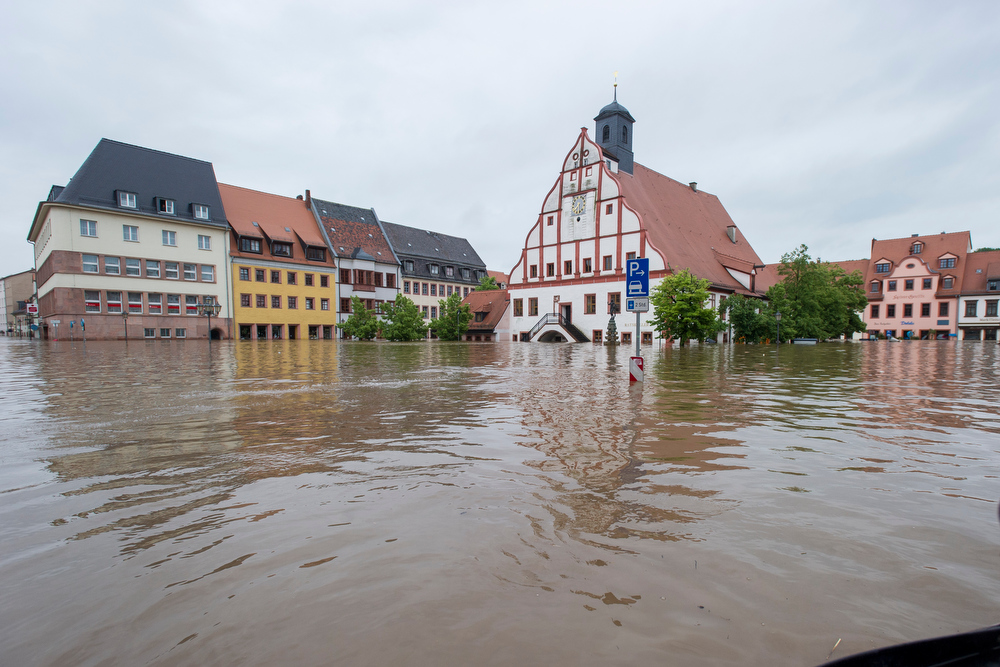 . Water fills the flooded market place in the city center on June 3, 2013 in Grimma, Germany. Heavy rains are pounding southern and eastern Germany, causing wide-spread flooding and ruining crops. At least two people are missing and feared dead in what is evolving into the most serious flood levels since the so-called 100-year flood of 2002. Portions of Austria and the Czech Republic are also inundated. (Photo by Jens Schlueter/Getty Images)