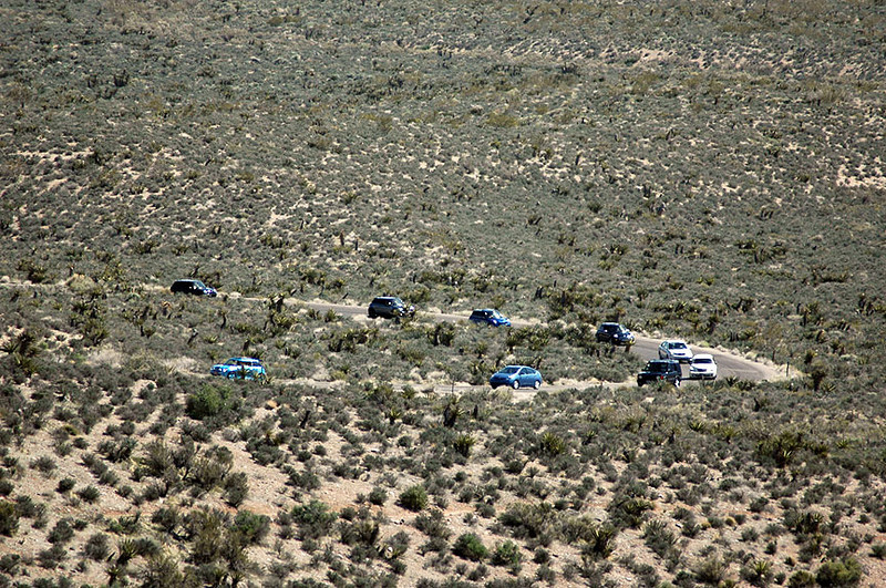 A convoy of MINIs (and a few interlopers) heading up the Red Rock Park scenic loop drive.