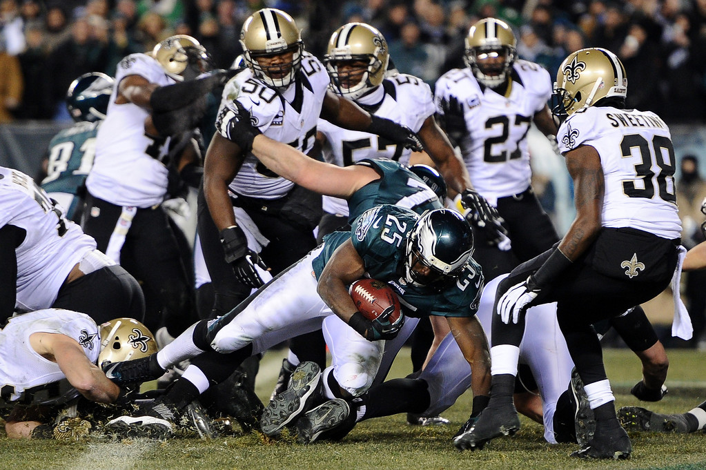 . PHILADELPHIA, PA - JANUARY 04:  LeSean McCoy #25 of the Philadelphia Eagles scores a 1 yard touchdown in the third quarter against the New Orleans Saints during their NFC Wild Card Playoff game at Lincoln Financial Field on January 4, 2014 in Philadelphia, Pennsylvania.  (Photo by Maddie Meyer/Getty Images)