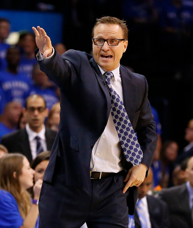 . Oklahoma City Thunder head coach Scott Brooks shouts to his team in the third quarter against the San Antonio Spurs of Game 3 of an NBA basketball playoff series in the Western Conference finals, Sunday, May 25, 2014, in Oklahoma City. Oklahoma City won 106-97. (AP Photo/Sue Ogrocki)