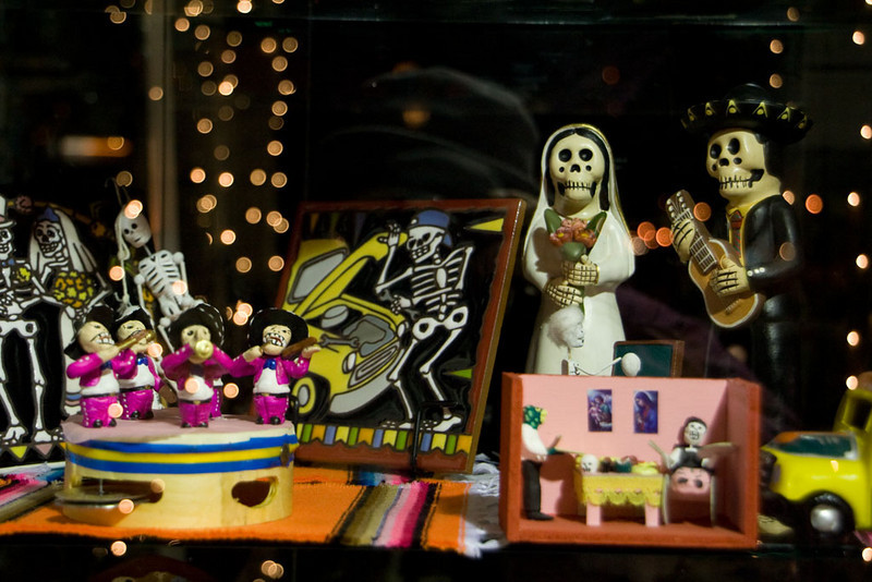Day of the dead figures in a shop window.