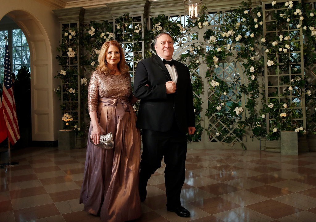 . CIA director Mike Pompeo and his wife Susan Pompeo arrive for a State Dinner with French President Emmanuel Macron and President Donald Trump at the White House, Tuesday, April 24, 2018, in Washington. (AP Photo/Alex Brandon)