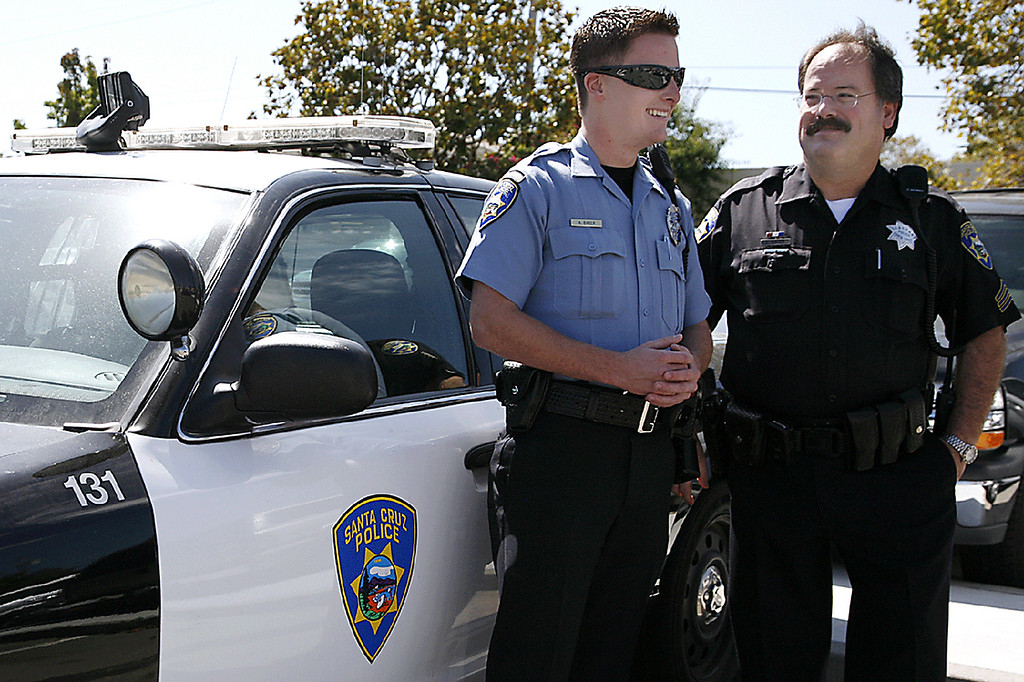. Loran \'Butch\' Baker with his son, Adam, when Adam joined the Santa Cruz Police as a Community Service Officer in September of 2010.  (Larissa Mueller/Sentinel)