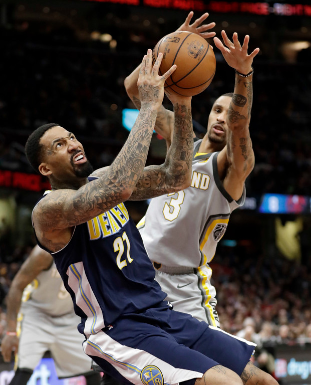 . Denver Nuggets\' Wilson Chandler (21) shoots against Cleveland Cavaliers\' George Hill (3) in the second half of an NBA basketball game, Saturday, March 3, 2018, in Cleveland. The Nuggets won 126-117. (AP Photo/Tony Dejak)