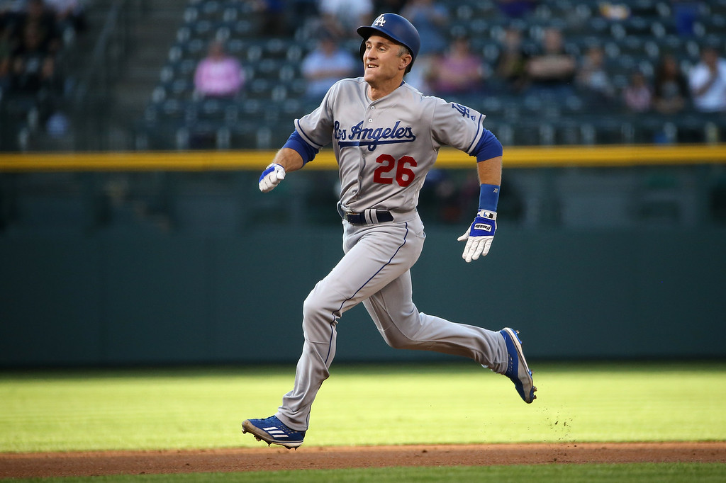 . DENVER, CO - APRIL 22:  Chase Utley #26 of the Los Angeles Dodgers glides into third with a lead off triple off of starting pitcher Jon Gray #55 of the Colorado Rockies in the first inning at Coors Field on April 22, 2016 in Denver, Colorado. (Photo by Doug Pensinger/Getty Images)