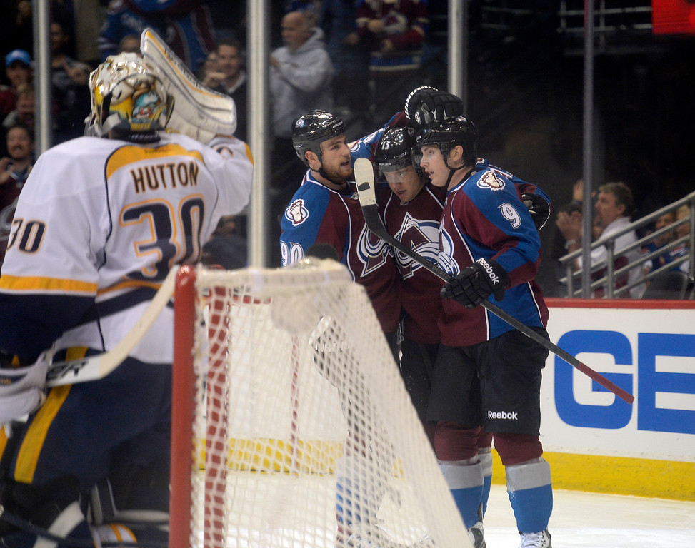 . Colorado Avalanche center Ryan O\'Reilly (90) and Colorado Avalanche center Matt Duchene (9) celebrate a goal by Colorado Avalanche right wing P.A. Parenteau (15) on Nashville Predators goalie Carter Hutton (30) in the first period November 6, 2013 at Pepsi Center. (Photo by John Leyba/The Denver Post)
