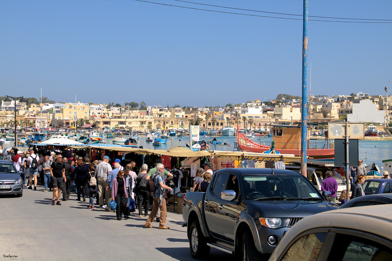 Malta.   Marsaxlokk Harbor and market    03/24/19.     This work is licensed under a Creative Commons Attribution- NonCommercial 4.0 International License