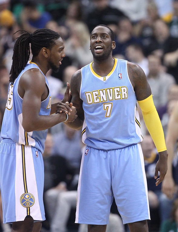 . Denver Nuggets\' Kenneth Faried, left, shakes the hand of teammate J.J. Hickson (7) after scoring in the second half during an NBA basketball game against the Utah Jazz Monday, Nov. 11, 2013, in Salt Lake City. The Denver Nuggets won 100-81. (AP Photo/Rick Bowmer)