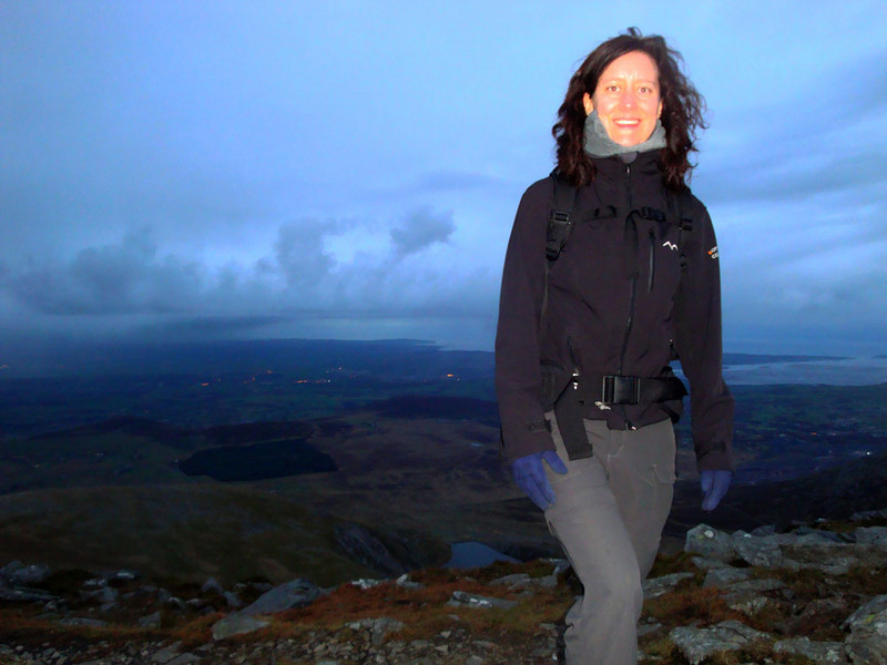Jasmijn on Elidir Fawr. The whole of NW Wales is visible below, and Ireland is visible on a good day. Unfortunately, however, it was about to become a very bad night. After carrying her rocks over the mountain range all day, the final 900 m odd descent nearly killed Jasmijn. Night fell and with it came freezing rain. The summer paths I recalled had become torrents which we had to navigate by fading torchlight. Jasmijn finally made it into Nant Peris, beyond exhaustion, still carrying her rocks! I had nobly assisted by eating some of her sweets to save weight. And carrying some of her smaller rocks.