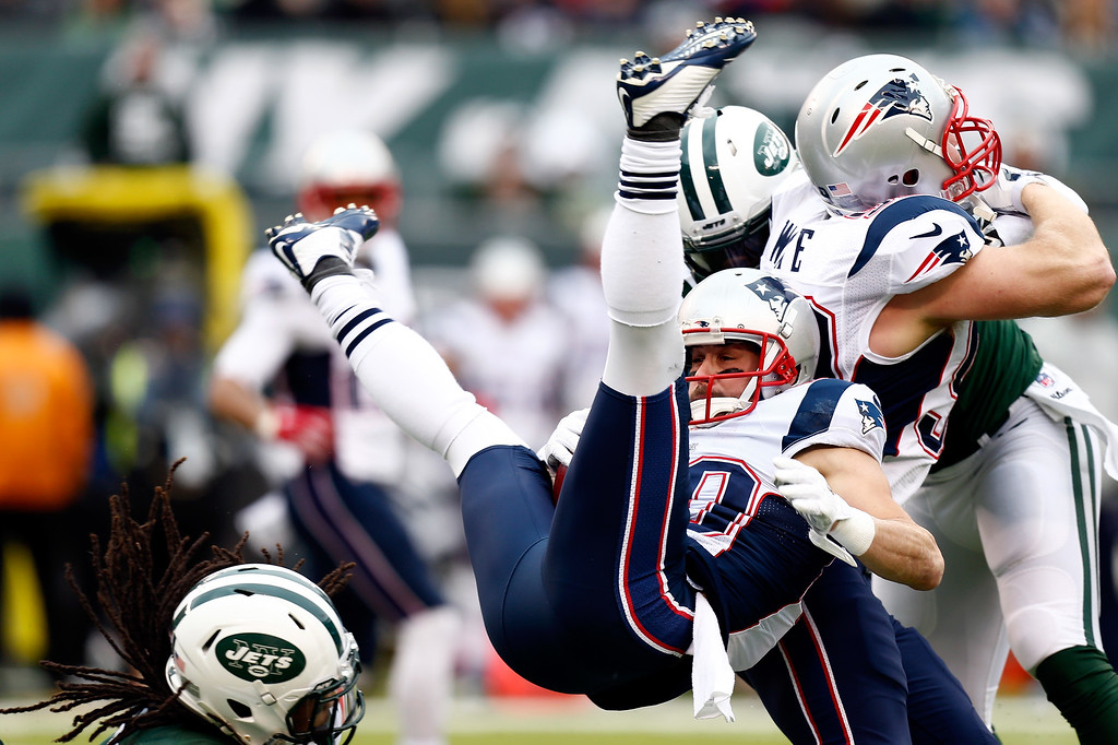 . EAST RUTHERFORD, NJ - DECEMBER 21:  Wide receiver Danny Amendola #80 of the New England Patriots is tackled by free safety Calvin Pryor #25 of the New York Jets in the first quarter during a game at MetLife Stadium on December 21, 2014 in East Rutherford, New Jersey.  (Photo by Jeff Zelevansky/Getty Images)