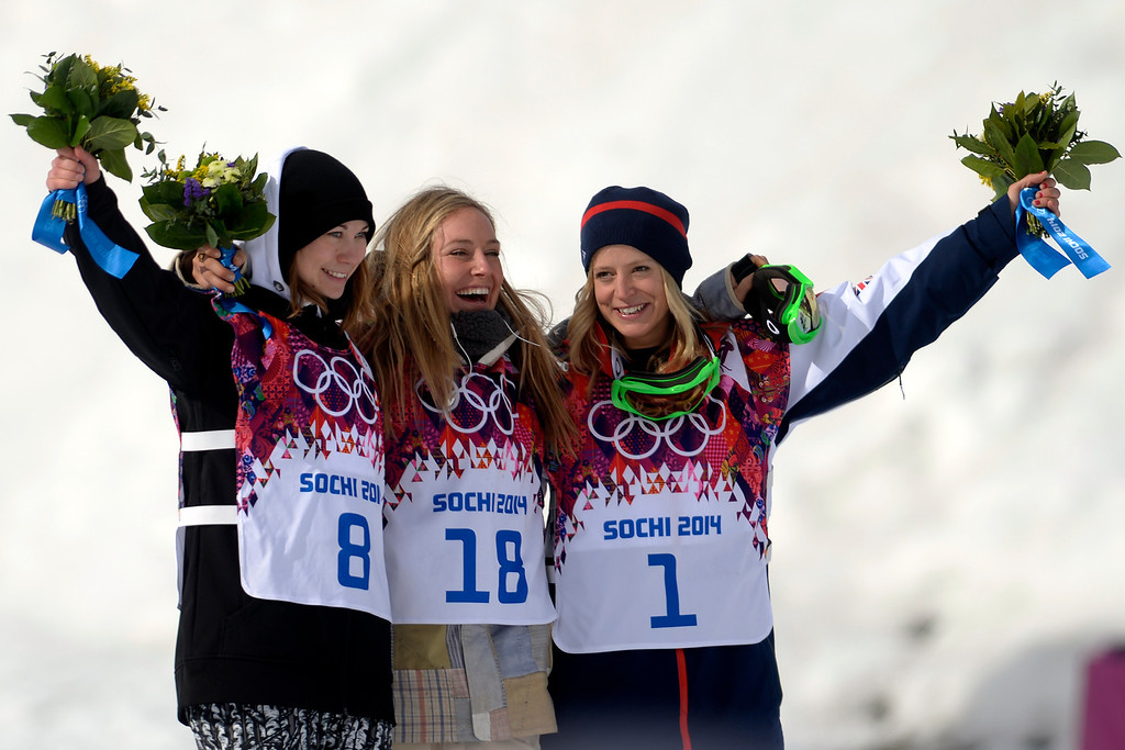. ROSA KHUTOR, RUSSIA - FEBRUARY 09: Gold medalist Jamie Anderson, of the United States (18), takes in the moment with silver medalist Enni Rukajarvi, of Finland (8) and Jenny Jones, of Great Britain (1) after the women\'s snowboard slopestyle final. Sochi 2014 Winter Olympics at the Rosa Khutor Etreme Park on Sunday, February 9, 2014. (Photo by AAron Ontiveroz/The Denver Post)
