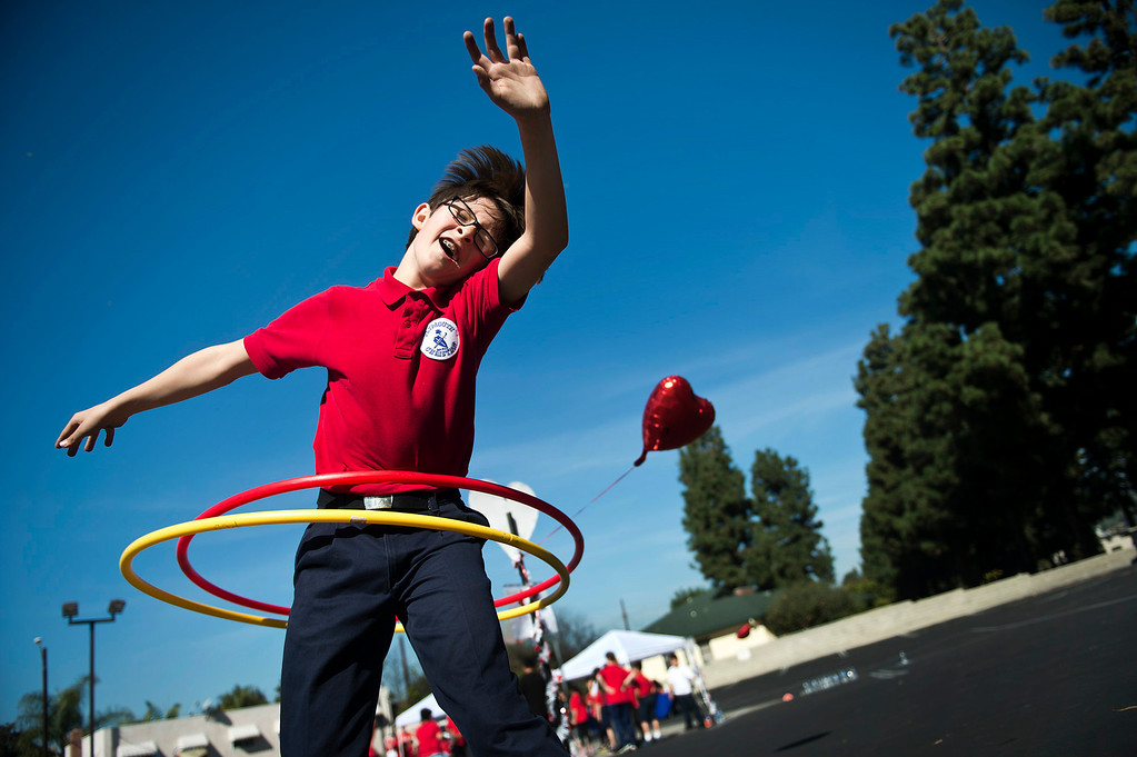. Tristan Swav, 9, spins Hula-Hoops during an exercise at Plymouth Christian School in Whittier on Friday, Feb. 14, 2014. The school held the exercise event to promote good health. (Photo by Watchara Phomicinda/ Whittier Daily News)