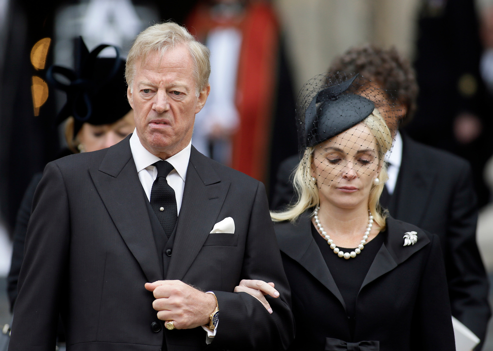 . Mark Thatcher and his wife Sarah leave after the ceremonial funeral service for former British Prime Minister Margaret Thatcher  in London, Wednesday, April 17, 2013. Thatcher, who died, at the age of 87 on 8 April, has been accorded a ceremonial funeral with military honours, one step down from a state funeral, Thatcher was elected Prime Minister on May 4, 1979 and she resigned on Nov. 28, 1990, after eleven years in office. (AP Photo/Alastair Grant)