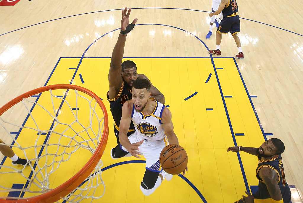 . Golden State Warriors guard Stephen Curry (30) shoots against the Cleveland Cavaliers during the first half of Game 1 of basketball\'s NBA Finals in Oakland, Calif., Thursday, June 1, 2017. (Ezra Shaw/Pool Photo via AP)