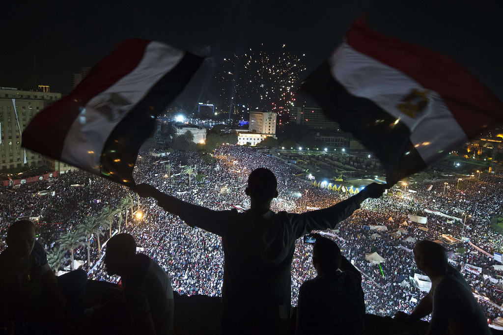 . Supporters of Egyptian Armed Forces General Ahmed Fattah al-Sisi rally at Tahrir Square in Cairo on July 26, 2013. Egypt formally detained Mohamed Morsi for allegedly abetting militants in murdering policemen and staging prison escapes, as clashes during massive rallies by his opponents and loyalists killed five people. KHALED DESOUKI/AFP/Getty Images