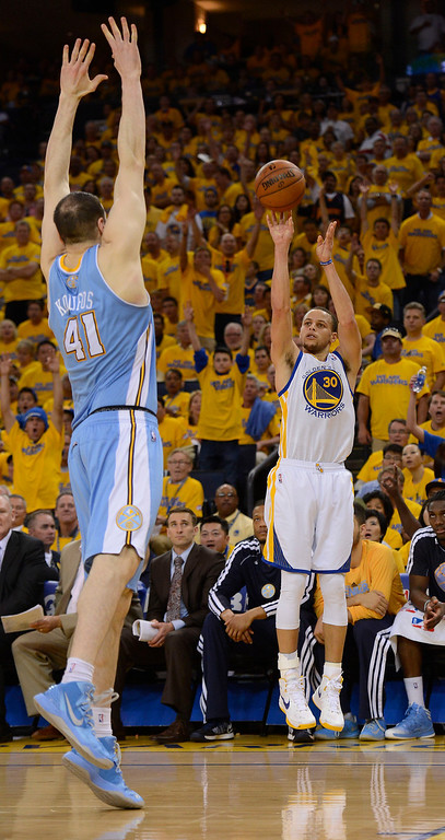 . Stephen Curry (30) of the Golden State Warriors hits a three pointer over Kosta Koufos (41) of the Denver Nuggets during the fourth quarter in Game 4 of the first round NBA Playoffs April 28, 2013 at Oracle Arena. Curry had a game high of 31. (Photo By John Leyba/The Denver Post)