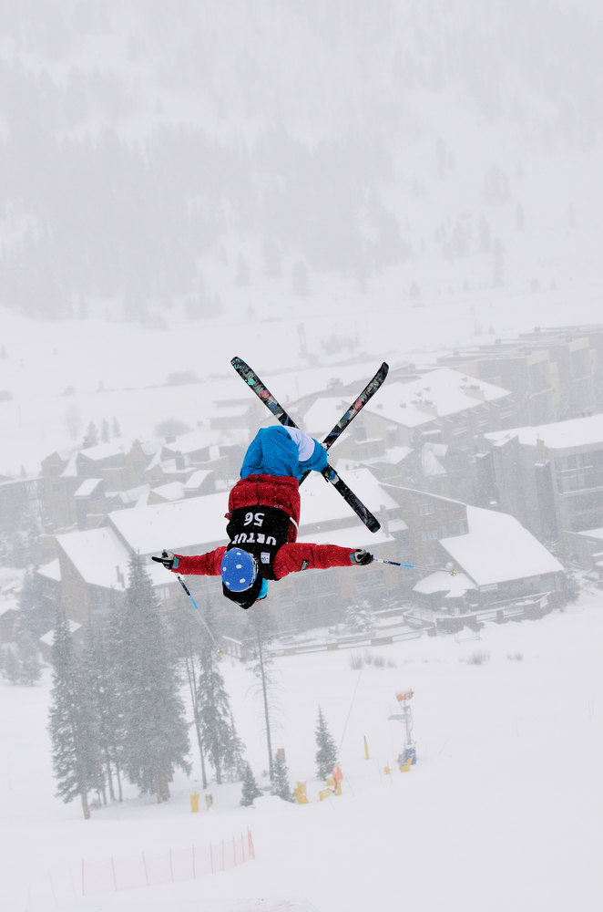 . Copper Mountain\'s East Village is barely visible through the falling snow as a competitor soars through the air during the U.S. Freestyle Moguls Selection event Wednesday morning. Summit Daily/Mark Fox