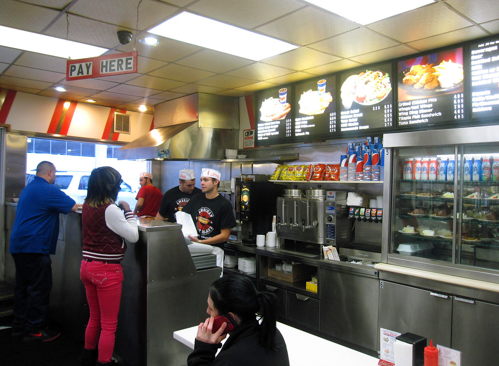 . This Dec. 2, 2014 photo shows the interior of American Coney Island in Detroit. The eatery is known for Coney Island-style hot dogs, which are served with onions, mustard and chili. American was founded by current owner Grace Keros� grandfather, a Greek immigrant, in the early 20th century. A rival eatery, Lafayette Coney Island, is located next door and many locals swear allegiance to one or the other. (AP Photo/Beth J. Harpaz)