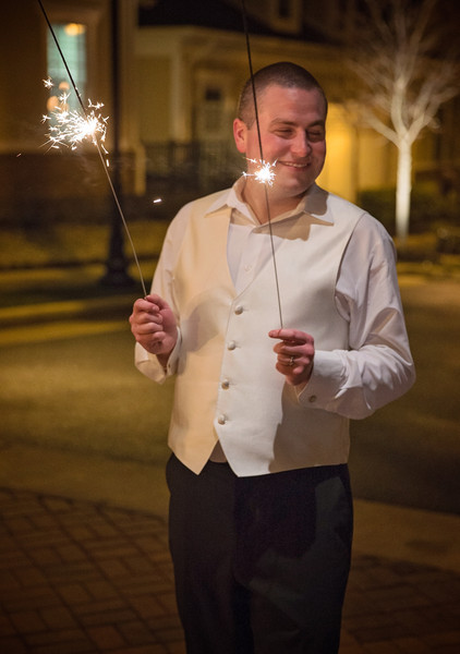 Groom with sparklers.jpg