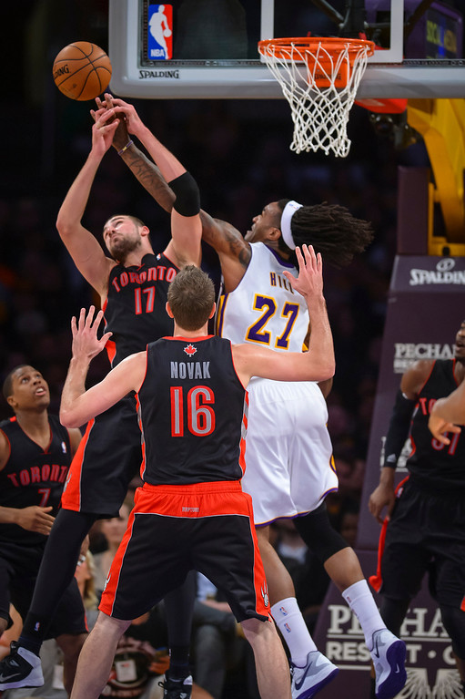 . Raptors� Jonas Valanciunas and Lakers� Jordan Hill go for a rebound  during second half action at Staples Center Sunday, December 8, 2013.  Lakers lost to the Raptors 94-106 as Bryant returned to action for the first time this season.  ( Photo by David Crane/Los Angeles Daily News )
