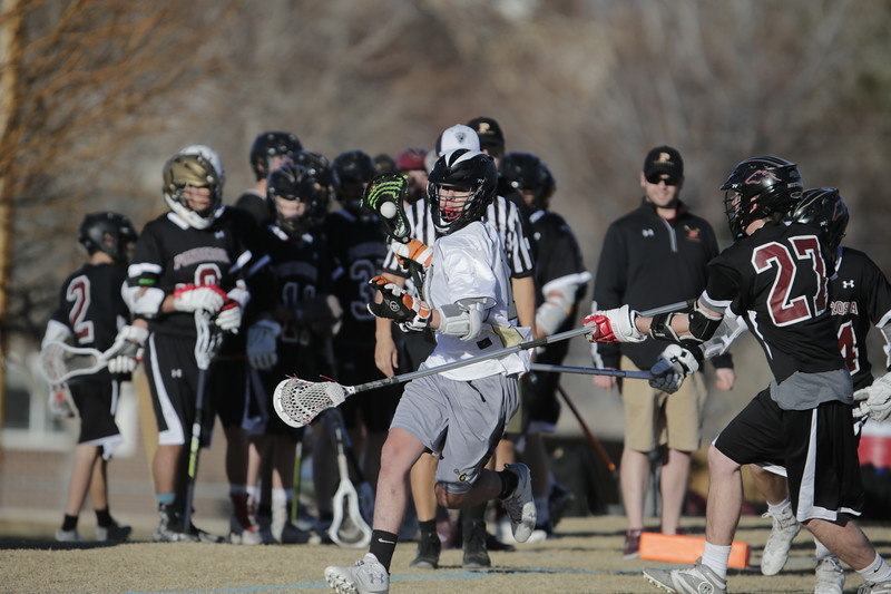 JPM0051-JPM0051-Jonathan first HS lacrosse game March 9th.jpg
