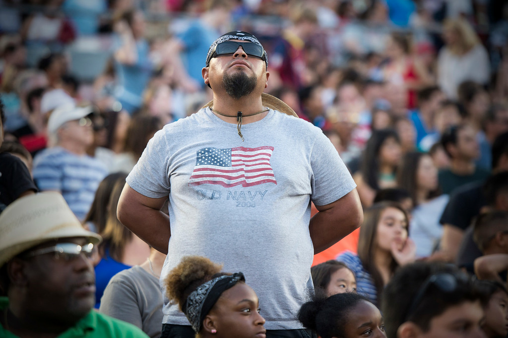 . Veteran AtaIgnacio Viera, a Temple city resident who served a tour in Iraq, stands as veterans are honored during the 88th Annual Fourth of July Celebration, Americafest at the Rose Bowl in Pasadena Friday night, July 4, 2014. (Photo by Sarah Reingewirtz/Pasadena Star-News)