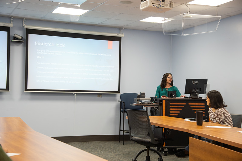 Sara Rodriguez (right) giving her presentation at the Honors Symposium.