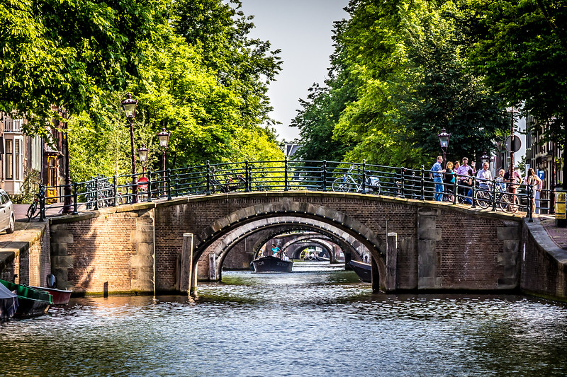 One view through many bridges along an Amsterdam canal.