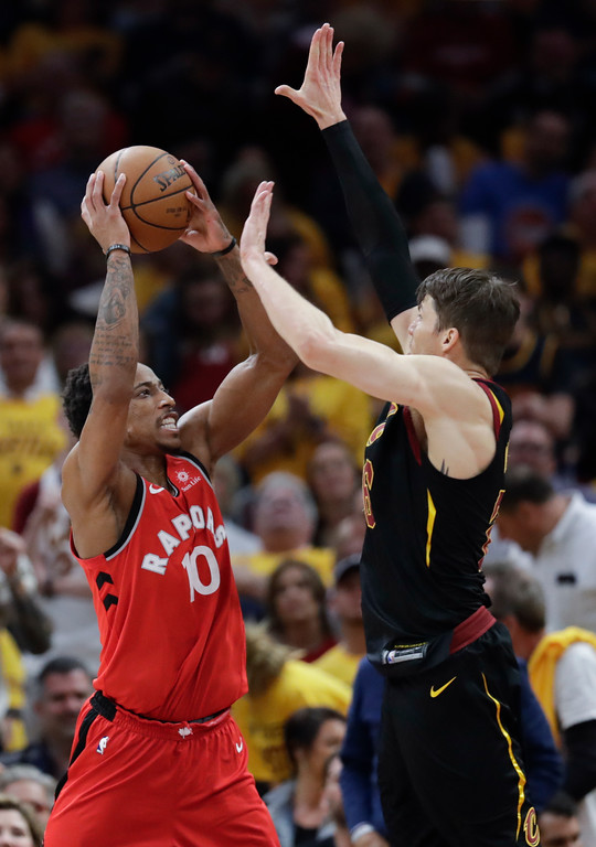 . Toronto Raptors\' DeMar DeRozan (10) goes up for a shot against Cleveland Cavaliers\' Kyle Korver in the first half of Game 4 of an NBA basketball second-round playoff series, Monday, May 7, 2018, in Cleveland. (AP Photo/Tony Dejak)