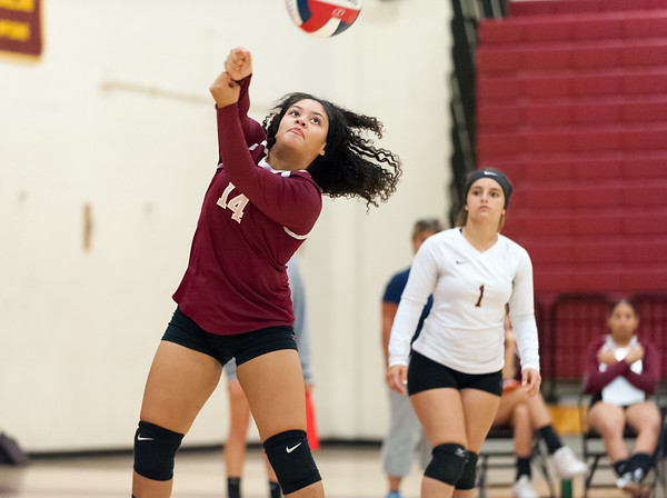 09/25/18 Wesley Bunnell | Staff New Britain girls volleyball was defeated by Simsbury on Tuesday night at New Britain High School. Kailah Gonzalez (14).