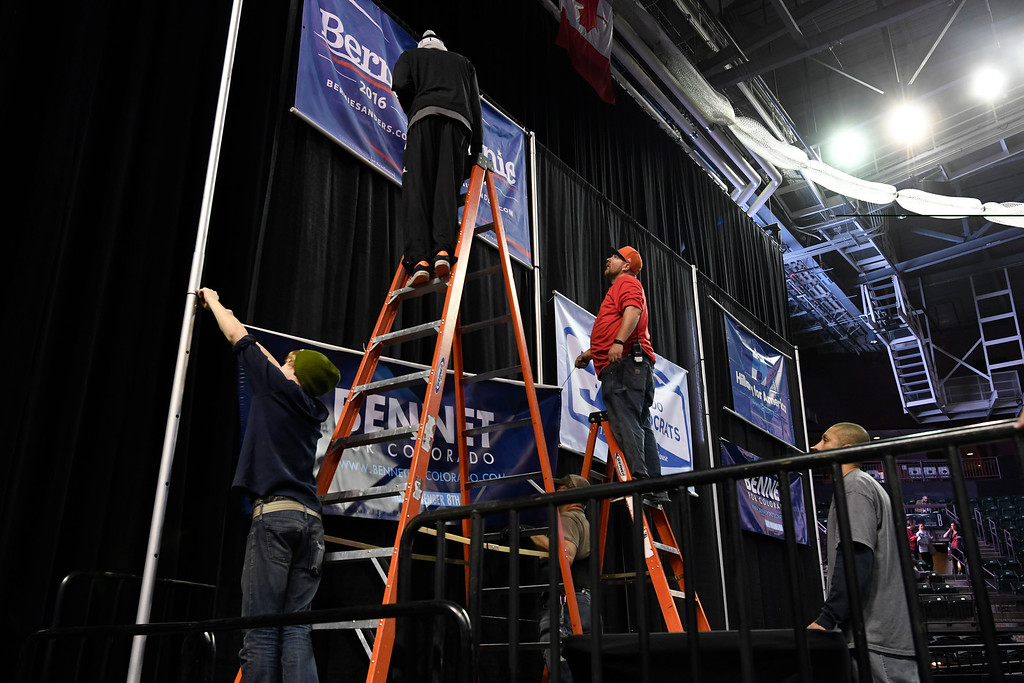 . Crews put the final touches on the stage at the Colorado Democratic State Convention at the Budweiser Events Center April 17, 2016. (Photo by Andy Cross/The Denver Post)