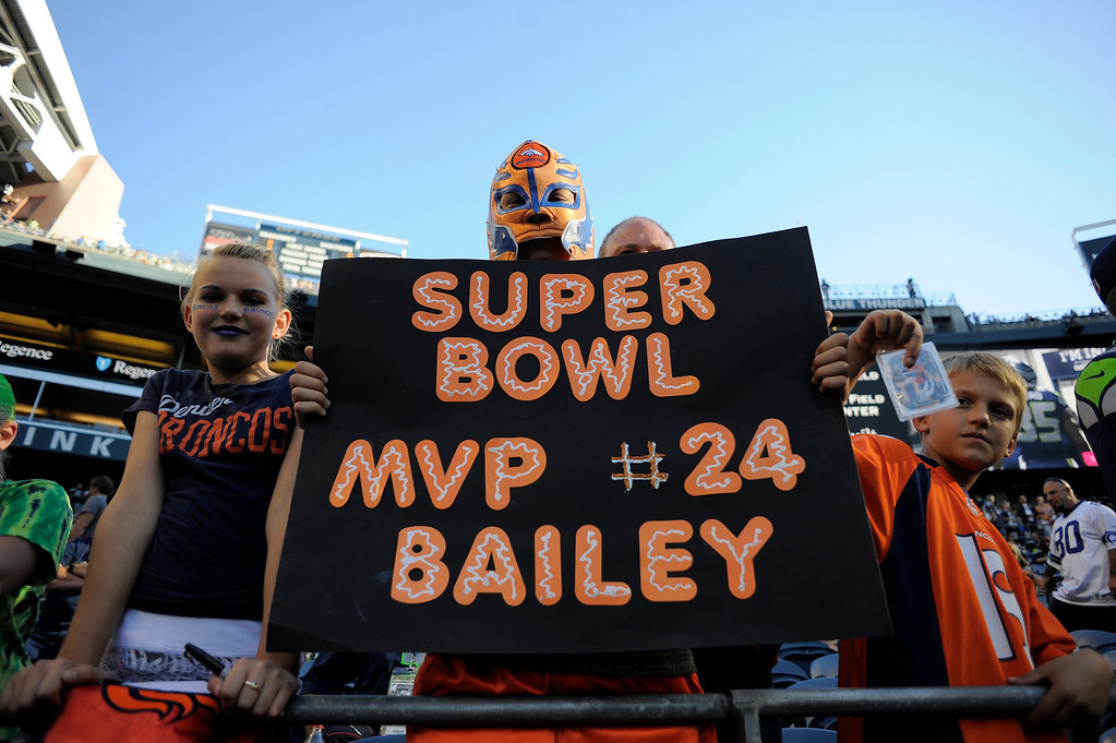 . SEATTLE, WA. - AUGUST 17: Denver Broncos fan Ethan Howard 13, of Oregon holds up his sign during the teams warm up August 17, 2013 at Century Link Field. (Photo By John Leyba/The Denver Post)