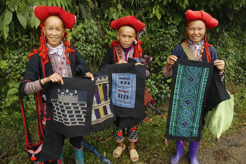 Displaying their handicraft.