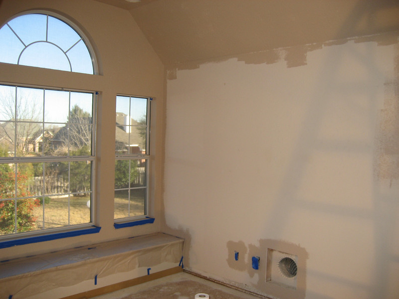 Priming the walls with Kilz 2 tinted 50% of the final coat.