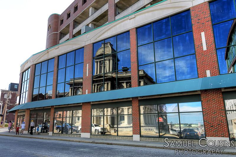 Custom House building reflected in windows across the street