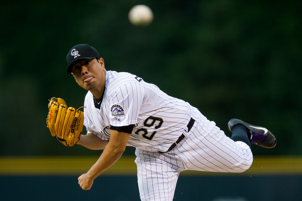 . DENVER, CO - AUGUST 30:  Jorge De La Rosa #29 of the Colorado Rockies delivers a pitch against the Cincinnati Reds in the first inning of a game at Coors Field on August 30, 2013 in Denver, Colorado. (Photo by Dustin Bradford/Getty Images)