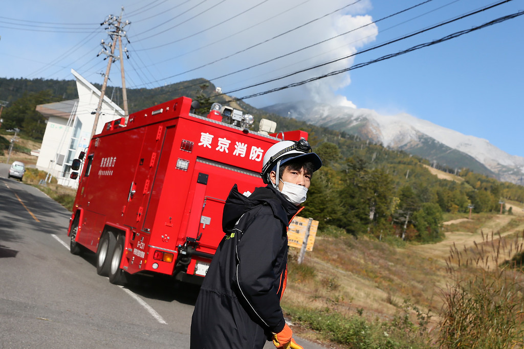. Mt. Ontake spews volcanic ash as search and rescue team workers moves to Mt. Ontake on September 28, 2014 in Otaki, Japan. The eruption of Mt. Ontake injured at least 32 people, and more than 250 hikers are still left stranded near the peak.  (Photo by Ken Ishii/Getty Images)